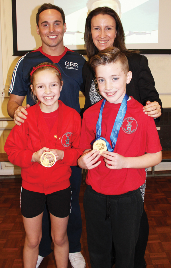 World champion gymnast and school ambassador Daniel Keatings with Windmill primary school headteacher, Miss Michelle Ginn and pupils Mason and Lacey, both aged 10