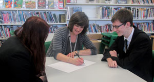 Carol Dallas works with Broadland students at an after-school session