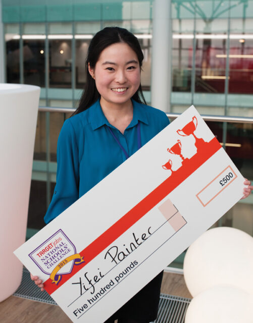 Yifei holding her winning £500 cheque after victory at the TARGETjobs competition