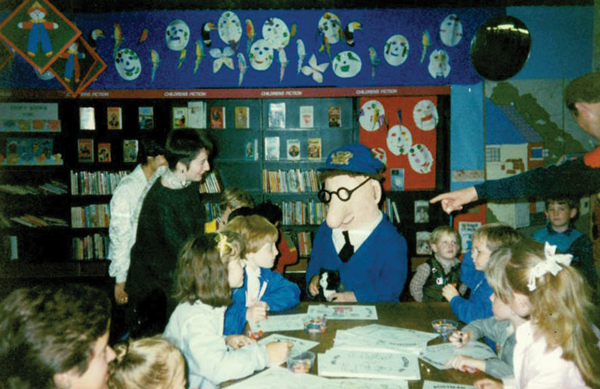 Lynda with Postman Pat and children at Newcastle Central Library in 1986