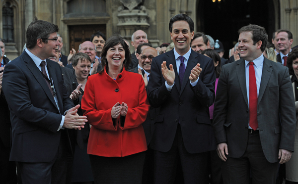 Former Labour leader Ed Miliband welcomes newly elected MPs to the House of Commons in London after 2012 by-elections, including Lucy Powell (second left)