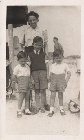 Twins Roy and Alan with older brother Brian in the middle and mother Dora behind