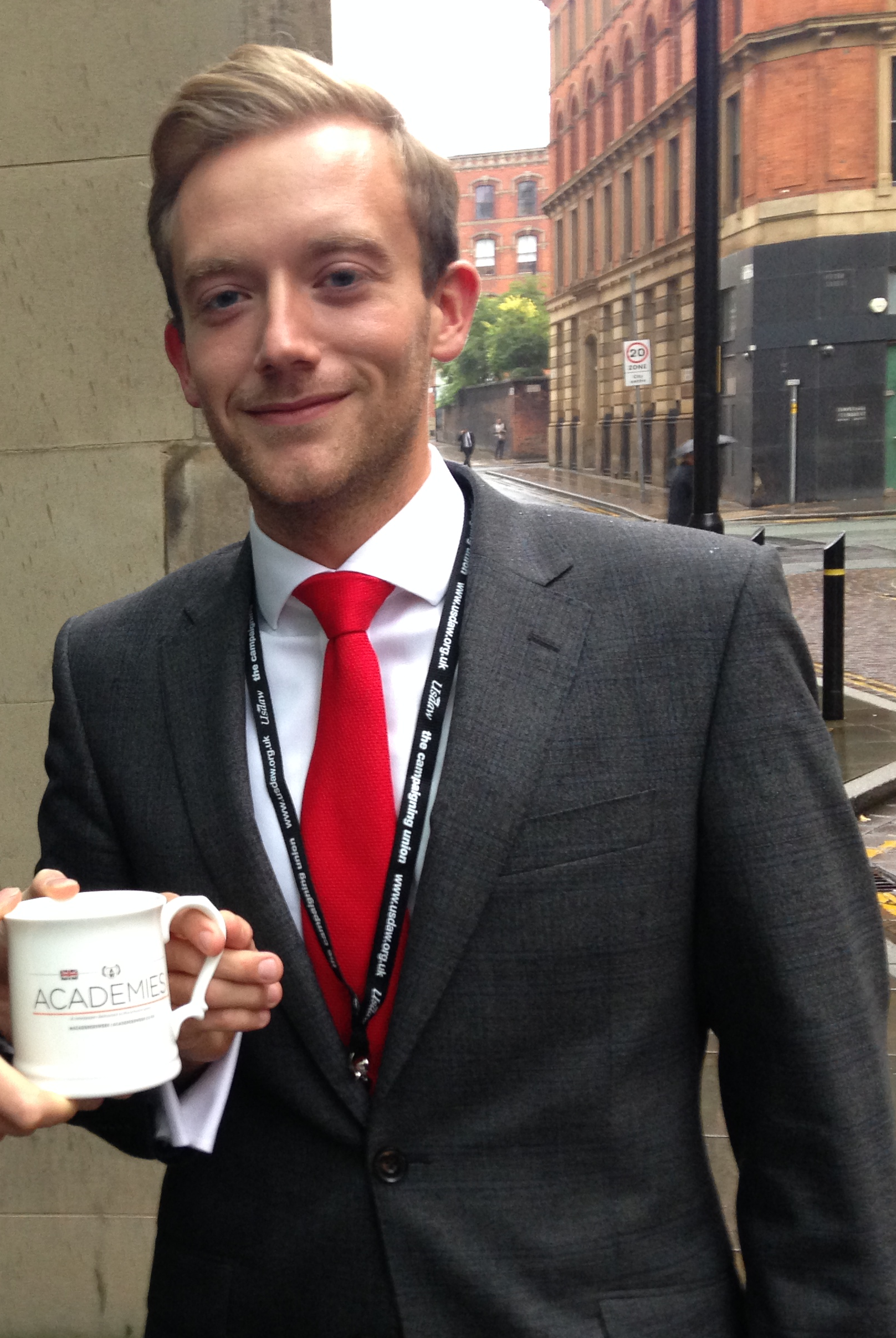 Schools Week managing director Shane Mann prepares to dig out the disregarded Academies Week mugs