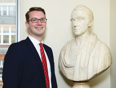 James Townsend with a bust of Joshua Watson